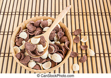 Close up sweet cereal in wooden bowl