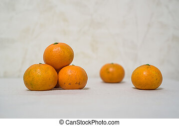 Close up tangerines on white table surface