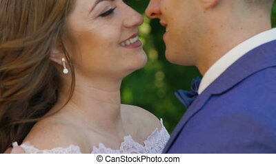 Close up tender caresses of wedding couple. Slowly