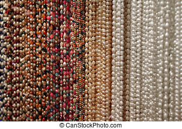 close up texture of colorful pearl beads