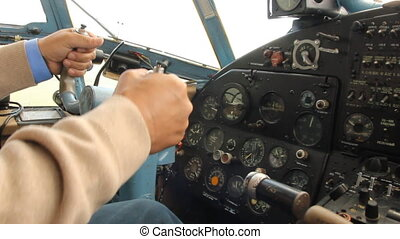 Close-up, the control wheel of a small aircraft in flight