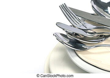 close up the dinning the silverware fork , spoon and knife with dish on white background and text space