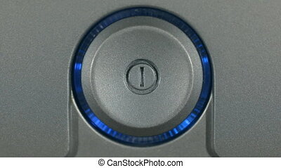 Close-up, the flicker of the control panel indicator....