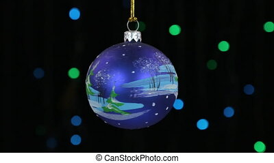 Close-up, the rotation of a blue Christmas ball hanged on a...