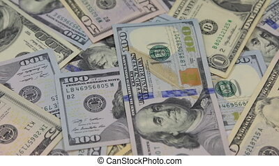 Close-up, the rotation of a heap of dollars. Business...