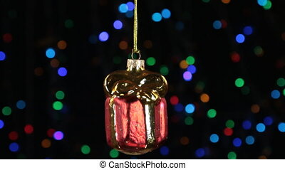 Close-up, the rotation of a red Christmas gift hanged on a...
