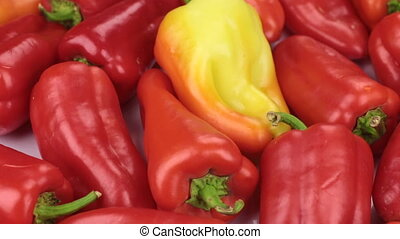 Close-up. The rotation of the background made from peppers....