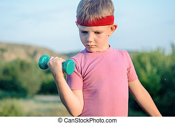 Close up Thoughtful Young Boy Lifting Dumbbell