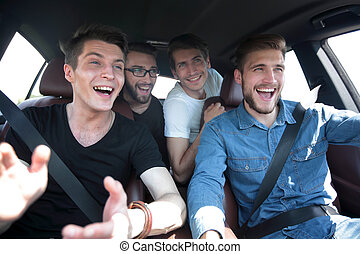 close up. three friends travel in a car