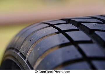 Close up tire texture pattern with blur background