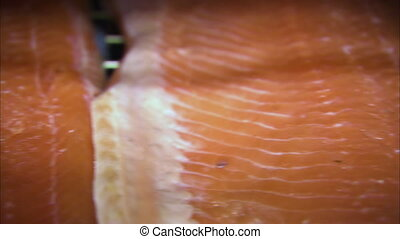 Close up to a smoked salmon meat - A close up shot of a...