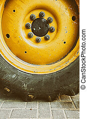 Close up to big heavy tire and wheel