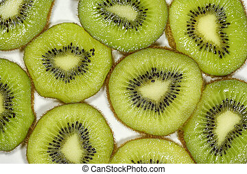 Close up top view macro kiwi fruit slices for background