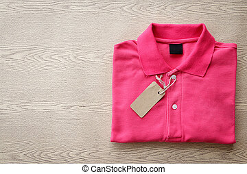 polo shirt - Close up top view of man polo shirt put on...