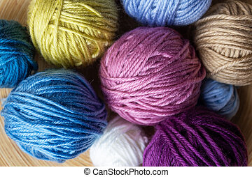 Close-up top view of multicolored woolen balls.