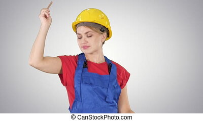 Tradeswoman dancing with a pencil on gradient background. -...