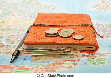 Close-up Travel Arrangement of Euro money, Map and notepad...