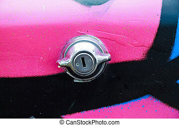 Close up trunk lock of pink colorful car