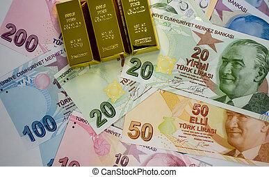 Close up Turkish lira banknotes and golds