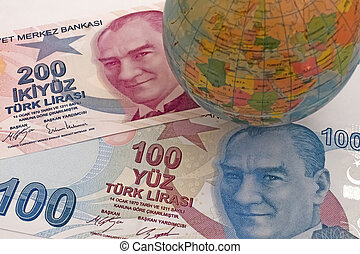 Close up Turkish lira banknotes with mini earth globe