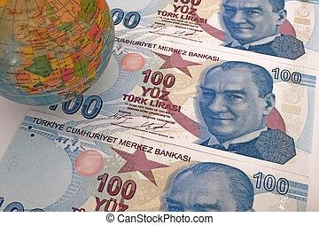 Close up Turkish lira banknotes with mini earth globe