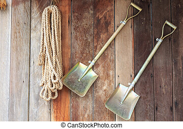 close up Two shovels on vintage wooden wall