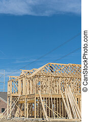Close-up two-story stick built home under construction in Irving