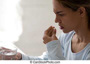 Close up unhealthy woman hold glass still water and pill