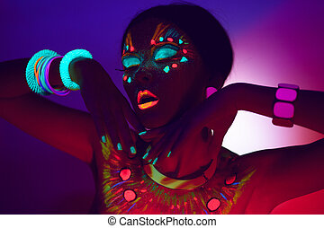 Close up UV profile portrait of a sensual young woman with artistic colorful makeup, isolated violet orange background.