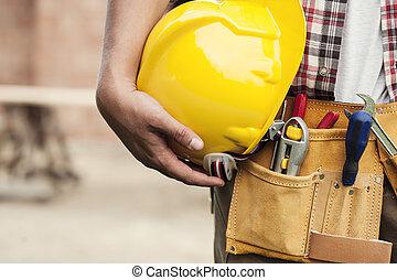 close-up, van, harde hoed, vasthouden, door, de arbeider van...