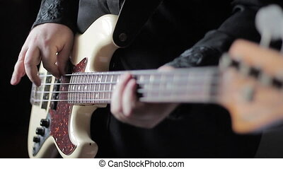 Close up video of bass guitar playing