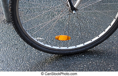 Close up view at a bicycle wheel with metal spokes