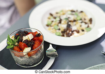 Chia puding and oat meal with fruits - Close up view at Chia...