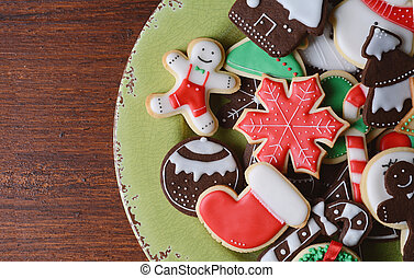 Close up view colorful christmas cookies on wooden table