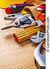 close up view hammer tape measure wrench nippers pliers ...