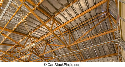 Close up view of a barn interior roof framework