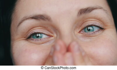 Close up view of a beautiful girl with green eyes smiling