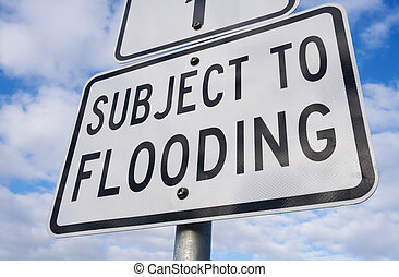 Close-up view of a flooding sign