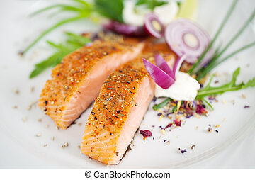 garnished salmon fillet dish - close-up view of a garnished ...