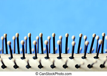 Close up view of a hair brush isolated on blue