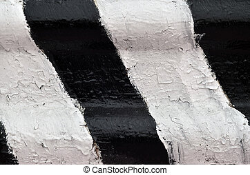 Close-up view of a metal barrier with striped color