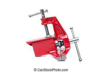 Close up view of a metal table vise clamp isolated on a white background.