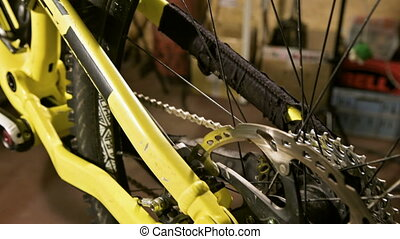 Close-up view of a mountain bike at a maintenance stand in a bicycle workshop