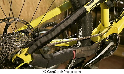 Close-up view of a mountain bike at a maintenance stand in a...