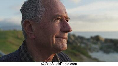Close up view of a senior man looking away