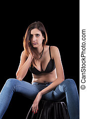 sensual young woman wearing lingerie and jeans