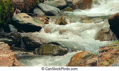 Close-up view of a small waterfalls of the tropical mountain river