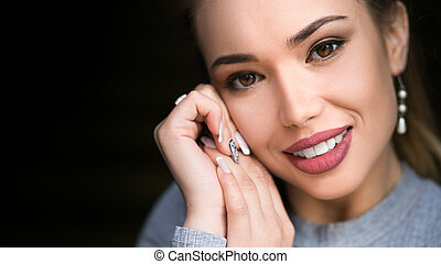 Close up view of a smiling woman with perfect teeth