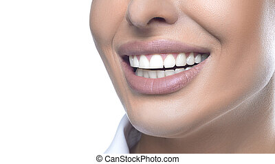 Close up view of a woman smiling. Teeth whitening concept.