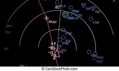 Flight navigation display of a modern airliner at night.